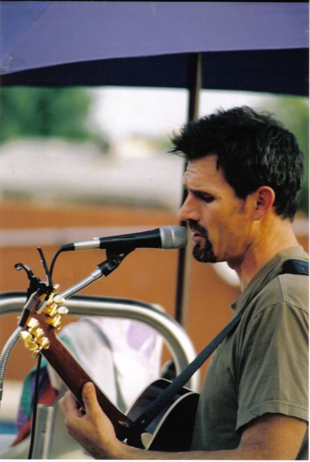 I was going to include a pic of myself leading worship, but I couldn't find any.  So, enjoy one of my favorite pictures of my husband of all time...