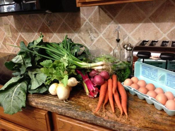 A friend's pic of this week's produce, in her kitchen. And you can't even see everything!! LOVELY. YUMMY!