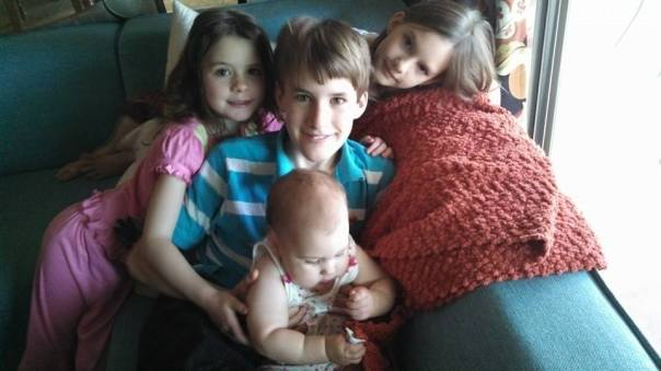 "From this morning.  Wesley was holding baby Jean and said, ""Take a picture, Mom!"" then Audrey and Fiala appeared to be a part of the picture-taking."