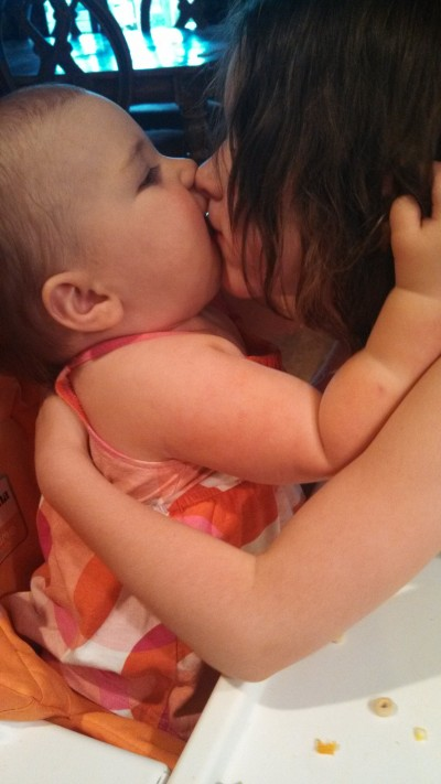 Baby Jean giving a hug and a sloppy kiss to Fiala.  I absolutely love the fact that baby Jean grabs both sides of someone's face and smashes her chubby, drooly mouth onto the kiss-recipient.