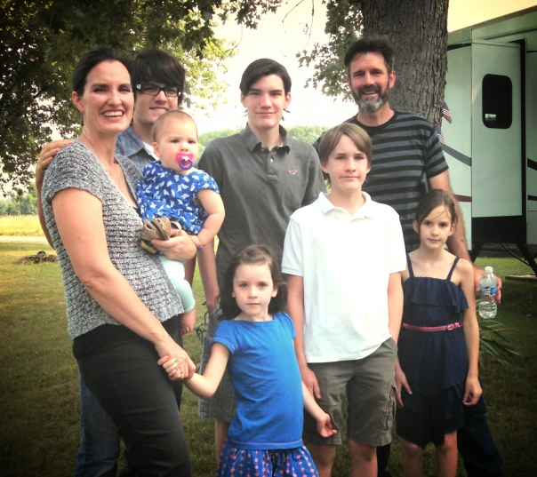 Our whole family, in July.  Wes is in the white polo.  I have the fewest pics of Wes of any of my children...  Must remedy that!!
